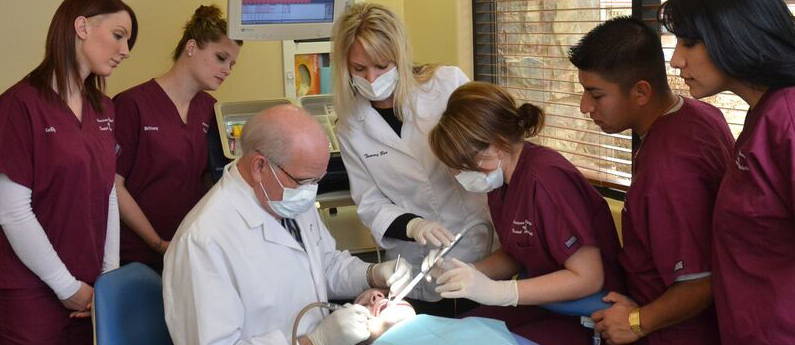 AIDA students learn hands-on helping patients in an onsite dental clinic